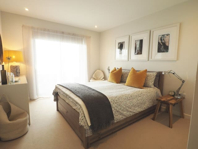 Bedroom, double bed and patio windows