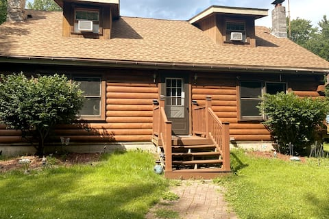 Cheerful 3-bedroom Cabin in the woods with a pool.
