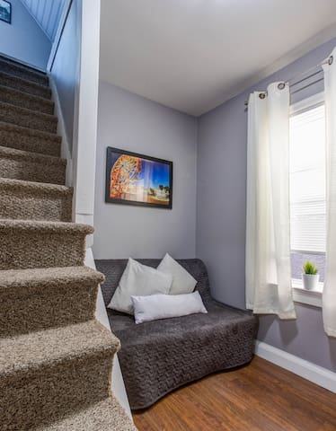 Second bedroom, has a double Ikea futon and is perfect one adult or two small sleepers.  This room has a door and is located off the dining room.  The stairs lead to the loft bedroom/office space.