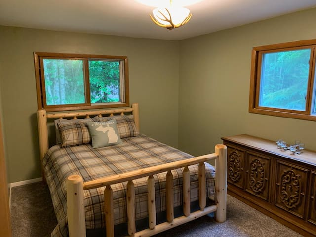 Queen Bedroom 2 has a new log bed frame, bedding and pillows. Bedroom has a dresser and accessible closet for clothes storage