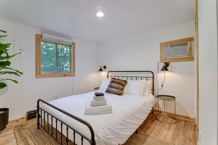 Downstairs is a full bedroom with queen size mattress, closet, mirror, and air conditioning.