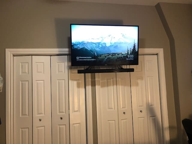 A closet for airbnb guests TV (with speaker and subwoofer) in the room with free youtube premium, Netflix, and IPTV with 10,000+ channels.