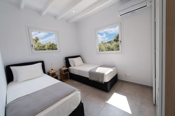 Bedroom 3: The two single beds could also be configured as a queen bed.