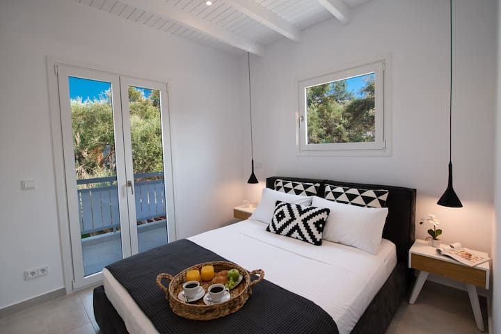 Bedroom 1: Beautiful space with a king size bed, overlooking a large garden