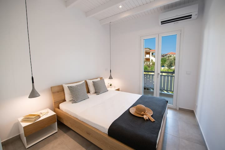 Bedroom 2: A beach-themed bedroom with a comfortable king size bed and views over the garden.