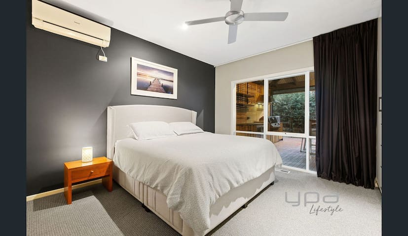 Master bedroom with queen size bed and full ensuite