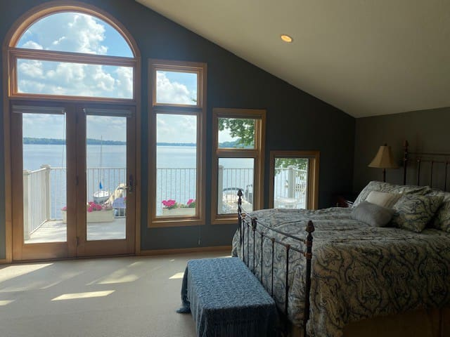 Second floor master bedroom (queen size bed) with private balcony