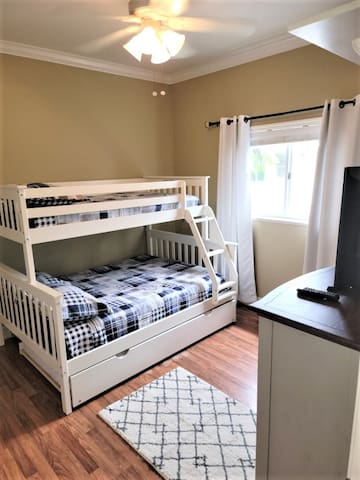 3rd bedroom offers a full size bed, single bunk on top and a single trundle bed below the full.