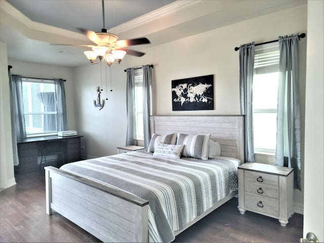 Master bedroom has a new King size bedframe, linens, end tables and dresser.