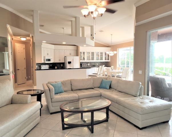 Open concept floorplan - view of living room into the kitchen/dining