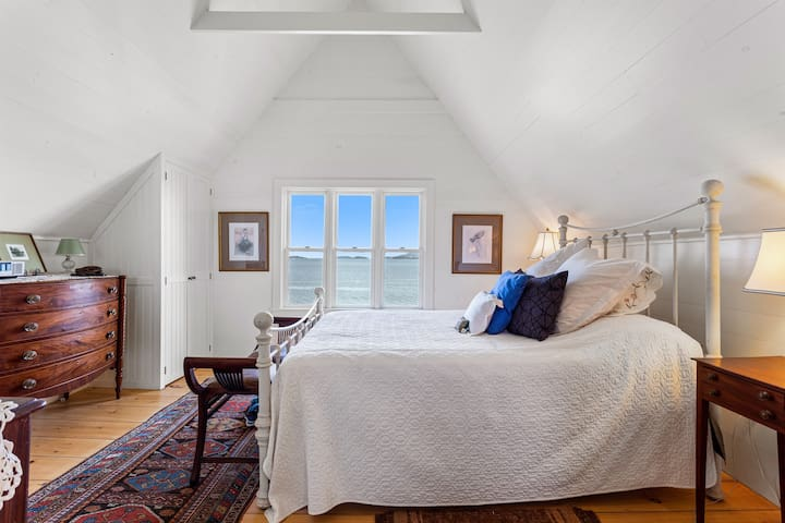 Bedroom 1, Queen Bed with direct views over ocean to Cadillac Mountain and Mount Desert Island.