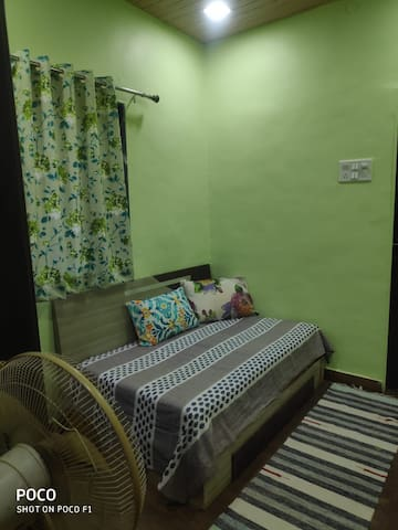 Green room. Smaller 3rd room with sofa cum bed. Pulls out into a double bed.