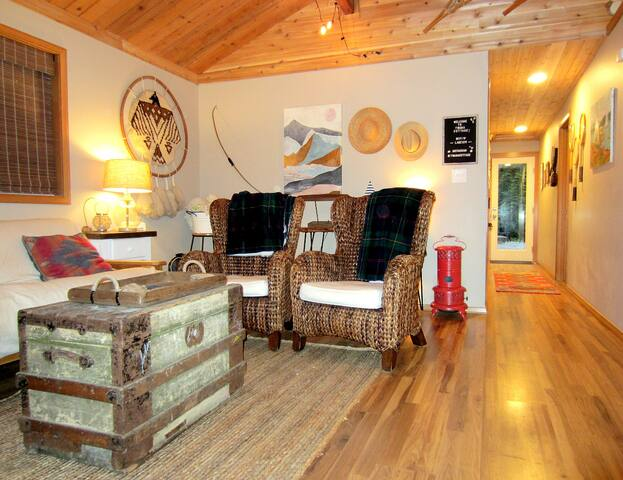 Cozy living room, includes a futon couch for extra guests.