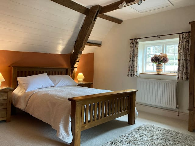 The cottage has a large master bedroom with a view over the village square.