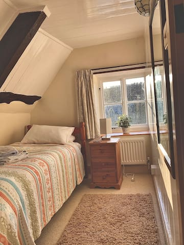 The single bedroom has a view over the garden.