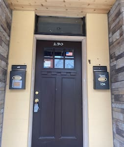 This is the main entrance door to the building. When you get to second floor door for the Apertment will be on the left.