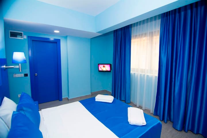 Deluxe Double Room. Room colors are based on availability.