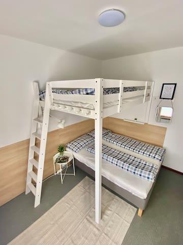 bedroom with additioanl bunker bed