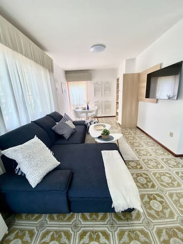"""large living room with smart TV 55"""" and sofa bed"""