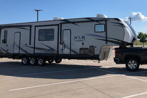 You book the site, We Deliver! Camper with deck!