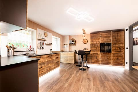 Moderno appartamento con giardino, sauna, barbecue