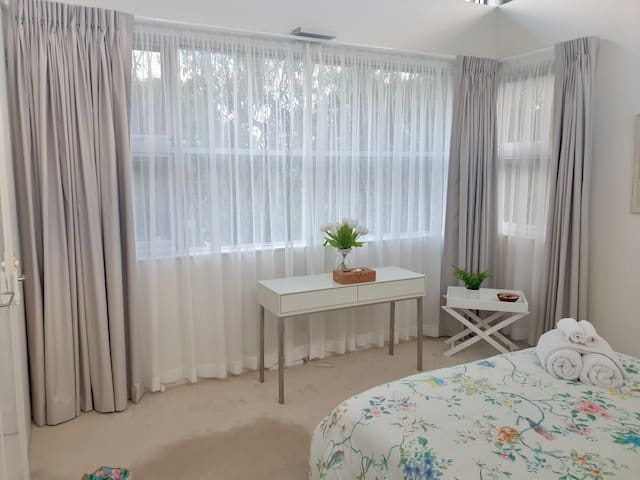 The Tree View room is luxurious and light filled. All bedrooms have ceiling fans and block out curtains. Quality cotton linen is provided in all bedrooms- no need to bring sheets and towels - just your beach towel.