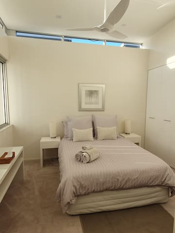 With three bedrooms, each with queen size beds, there is luxurious accommodation for three couples or family holidays. All bedrooms have built -in robes, ceiling fans, are light filled and airy.