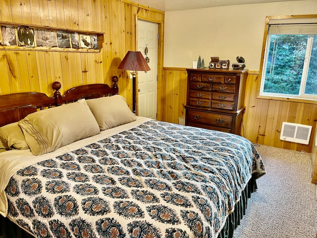 Bedroom 1 is downstairs and has a comfortable king sized bed. There is plenty of closet and storage space. A pack and play is provided for small children.