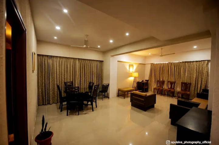 These are the following amenities at the living room 1. Workspace 2. High-speed broadband with Lan and wifi 3. Dining room 4. Sea view 5. Courtyard for barbeque 6. Video door call security system 7. Extensively illuminated and furnished