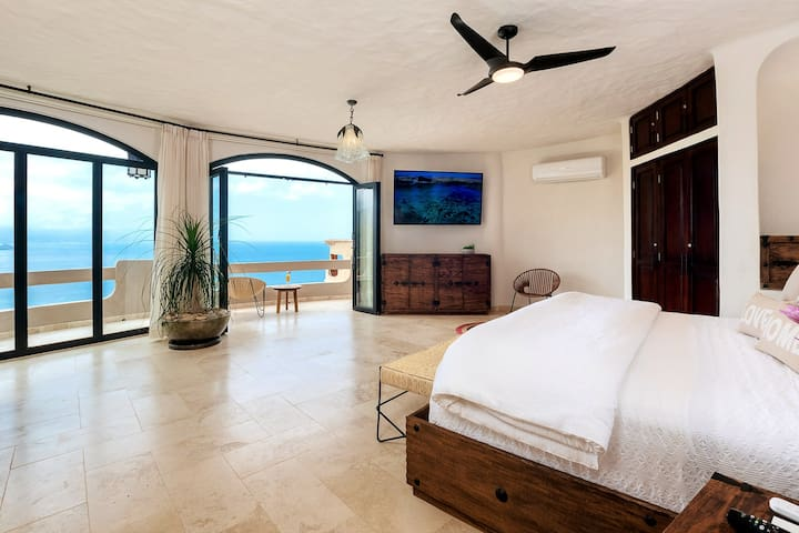 Main bedroom's spectacular ocean views. Private balcony, AC, TV, remote controlled blinds
