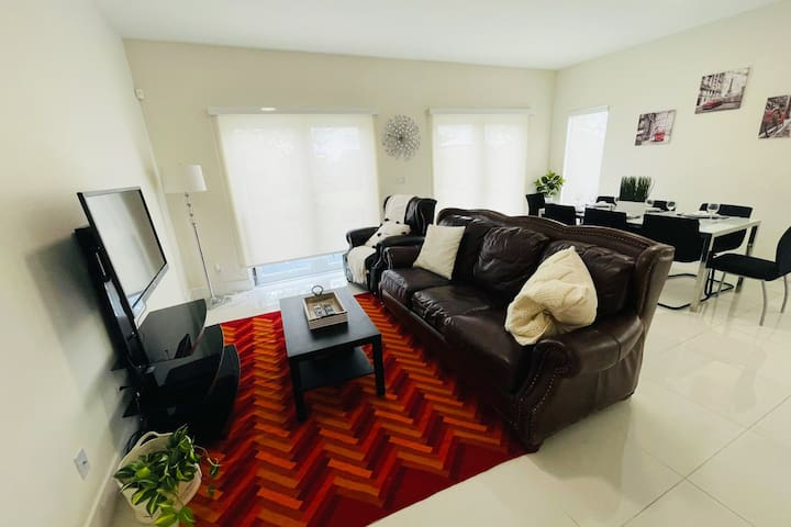 Beautifully decorated open concept dining/living rooms with modern and quality furniture!