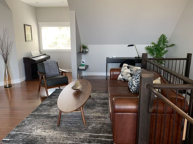 Cozy Living Room for a great family fun time with piano, board games, video games, book reading area, etc..