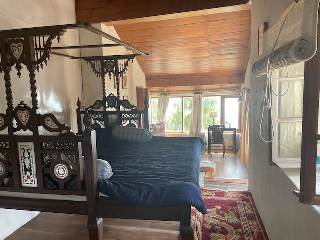 Master bedroom with king bed, daybed, work space and view!
