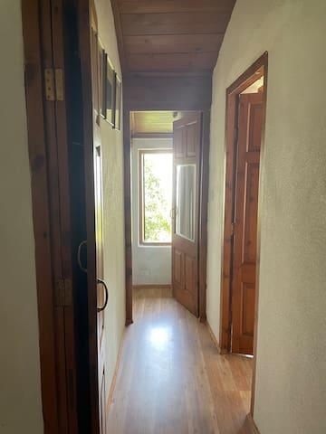 Corridor connecting the 3 bedrooms