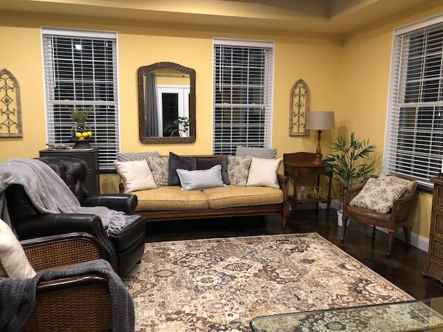 Large, spacious great room with combined dining, kitchen and living area.