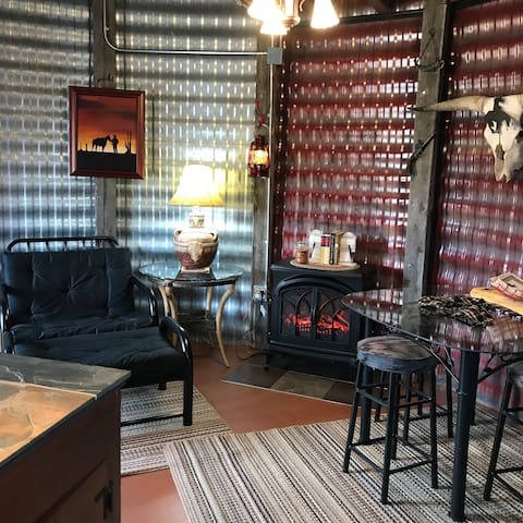 Downstairs area - electric fireplace, table and chairs, Futon chair