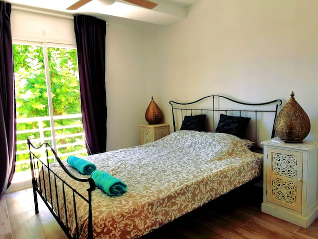The master bedroom with kingsize bed and build in wardrobes