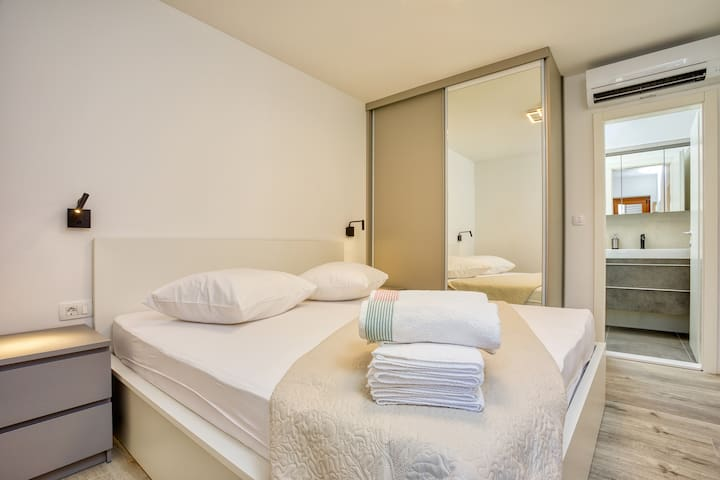 En suite bedroom with an AC, perfect for two people to enjoy