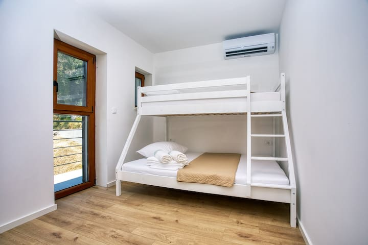 3rd bedroom with an AC system and  a bunkbed suitable for two people