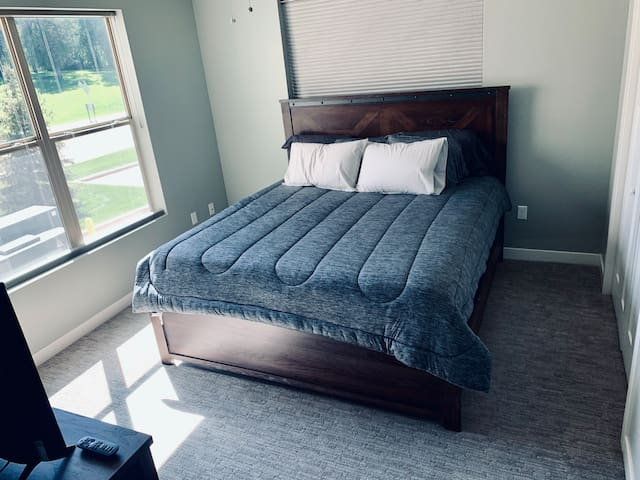 Master bedroom includes a king bed, TV, large closet, and private bathroom.