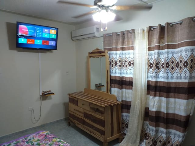 """45"""" High definition, internet connected TV. Watch your favorite shows on Netflix,  Amazon, Apple, You Tube or any other subscription or free service.   Air conditioning with remote control.  Ceiling Fans.   High quality curtains and drapes"""