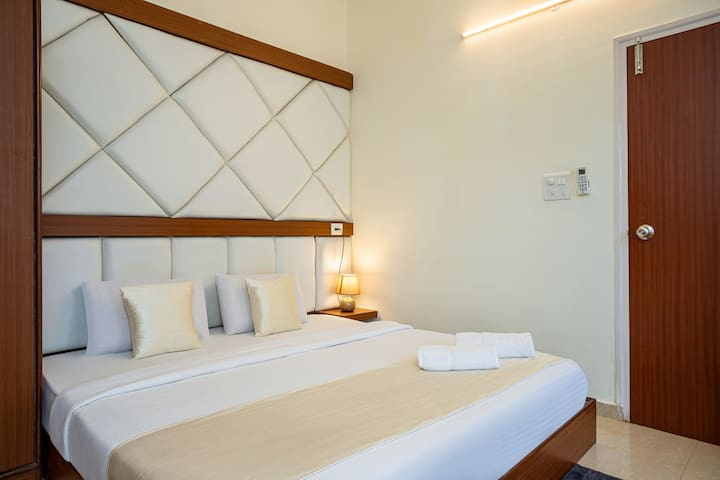 Modern King-Size Bed | Wingback Tufted Headboard | Bedside Tables | Split Air Conditioning