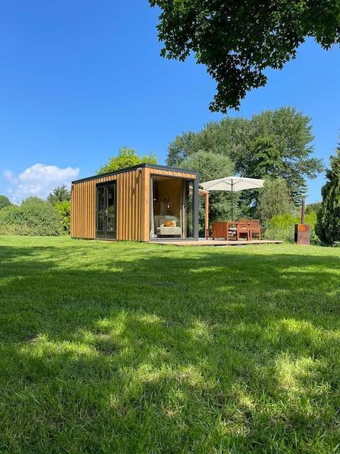 Tiny house met ruime plek op groene familiecamping