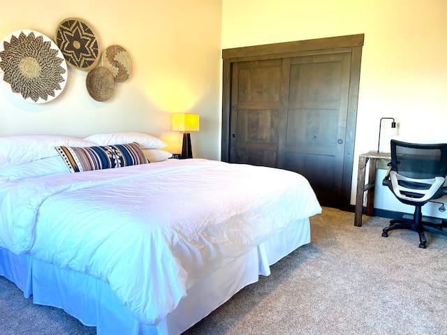 Master bedroom has desk/workspace.