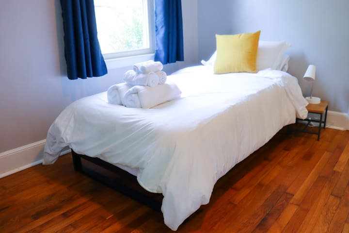 This bedroom contains two twin size Tuft & Needle Mint mattresses.