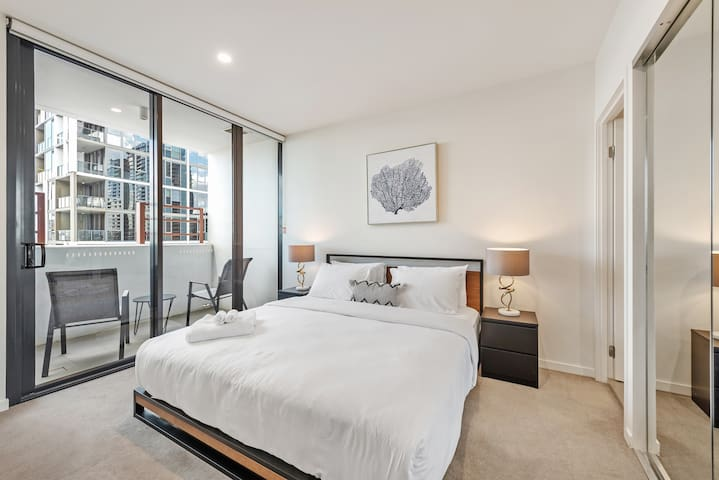 The master bedroom with ultra-comfy king bed, private balcony and deluxe ensuite