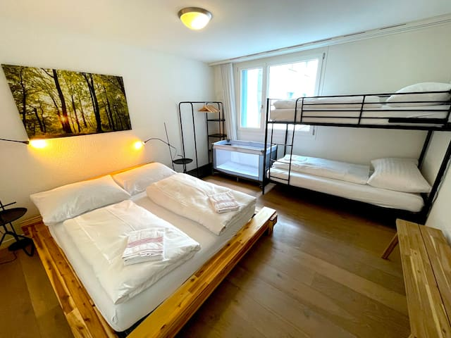 Spacious master bedroom that sleeps 4 adults and a baby