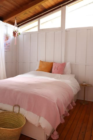 Will you pick the yellow or pink boho bedroom?
