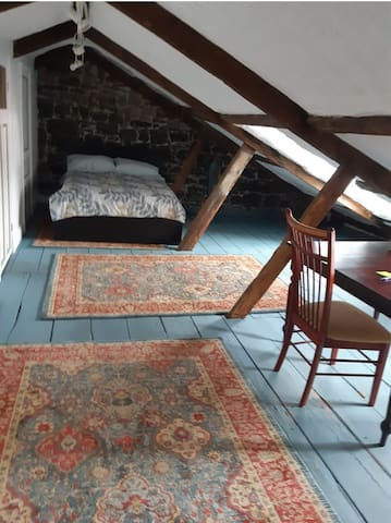 Bright, well-insulated attic with a double bed.