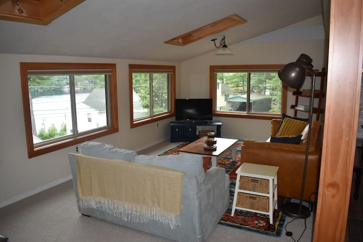 Our living room is lined with windows so you can enjoy the lake views!